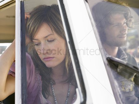 Moody : Couple in van head and shoulders woman looking out of window