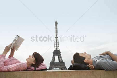 Pink : Couple lying on ledge of the trocadero with eiffel tower viewed in the background