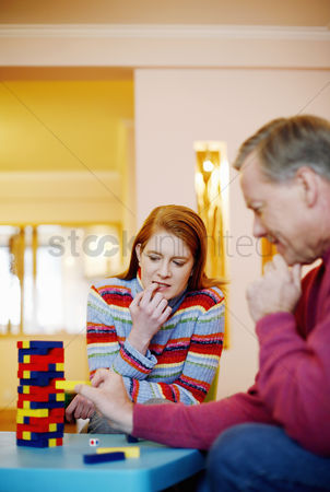 Careful : Couple playing block game at home