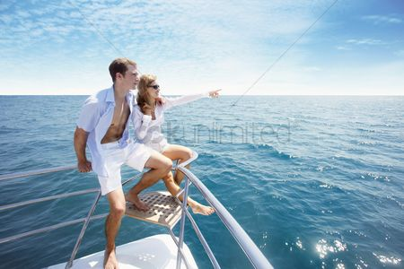 Transportation : Couple relaxing at the tip of the yacht