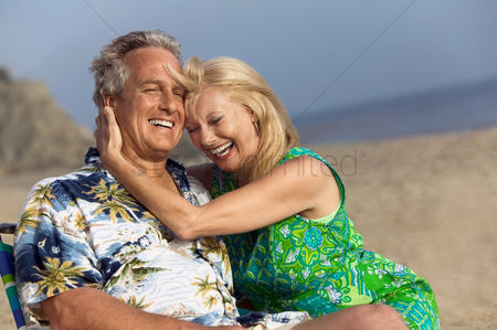 Mature : Couple relaxing on beach