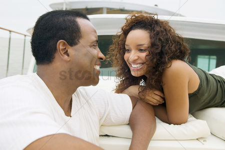 Curly hair : Couple relaxing on yacht