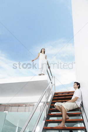 Stairs : Couple smiling while thinking
