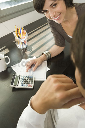 Tidy : Couple sorting out finances