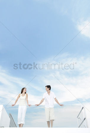 Relaxing : Couple standing at the balcony