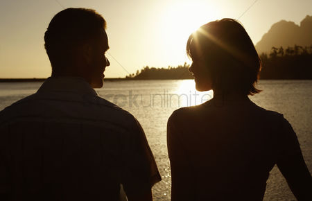 Two people : Couple standing by lake back view