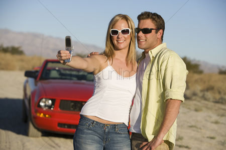 Accessibility : Couple taking a camera phone picture