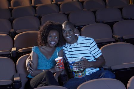 Food  beverage : Couple watching movie