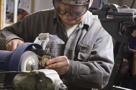 Sculpture : Craftsman working with stone close-up