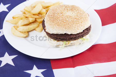 Flag : Cropped shot of chips and burger over america flag