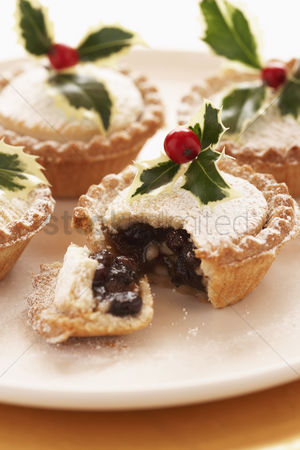 Celebration : Decorated mince pies on plate close-up