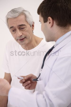 Thermometer : Doctor attending to his patient