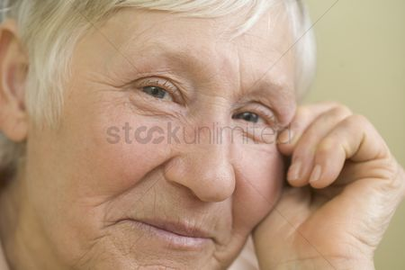 Face : Elderly woman with short grey hair  smiling
