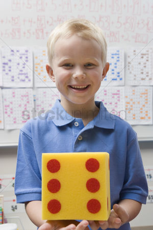 Posed : Elementary student with large die
