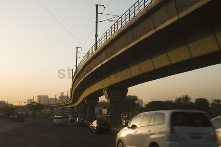 On the road : Elevated railway track over a road  new delhi  india