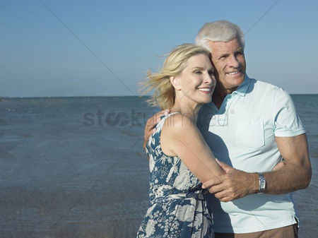 Kissing : Embraced senior couple on beach