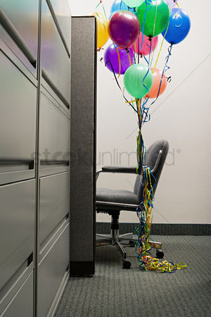 Interior : Empty office chair with balloons tied to it