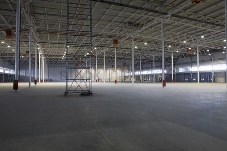 Spacious : Empty warehouse with scaffold