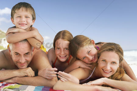 Daughter : Family lying on beach