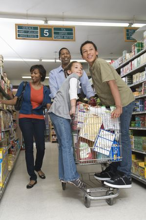 Pushing : Family of four shopping in supermarket