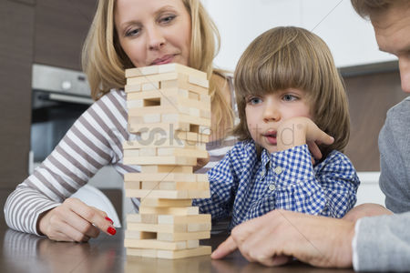 Toy : Family playing with wooden blocks at home