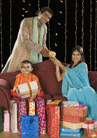 Diwali : Family with shopping bags and gifts on diwali festival