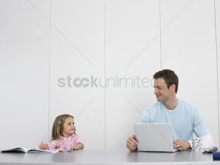 Productivity : Father and daughter drawing and using laptop