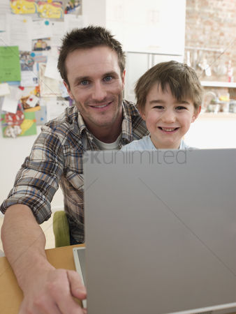 Offspring : Father and son at laptop