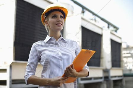 Eastern european ethnicity : Female architect with clipboard