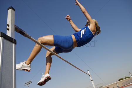 Ponytail : Female athlete high-jumping low angle view