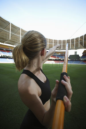 Ponytail : Female athlete throwing a javelin