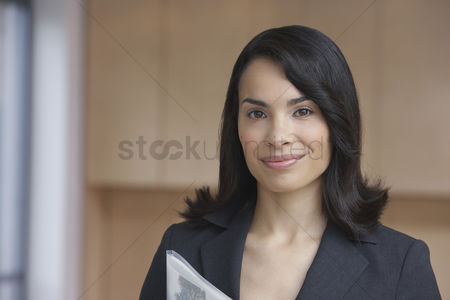 Cheerful : Female estate agent smiling portrait