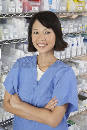 Medication : Female nurse in hospital room portrait