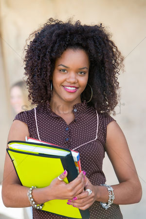 Notebook : Female student smiling outdoors  portrait