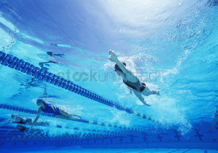 Swimmer : Female swimmers swimming in pool