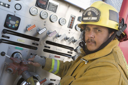 Truck : Firefighter at control panel of truck