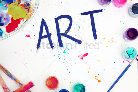 Paint brush : Flat lay of poster paints with the word art