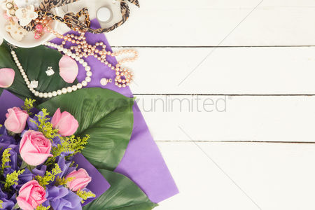 Blank : Flatlay of jewelry and bouquet of roses
