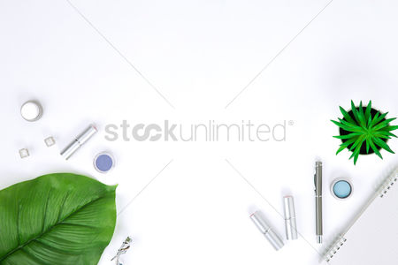 Notepad : Flatlay of white background with makeup accessories