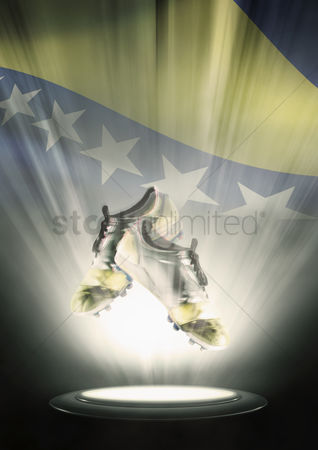 Bosnia and herzegovina : Football cleats with bosnia and herzegovina flag backdrop