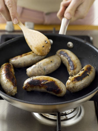 Hot dog : Frying sausages