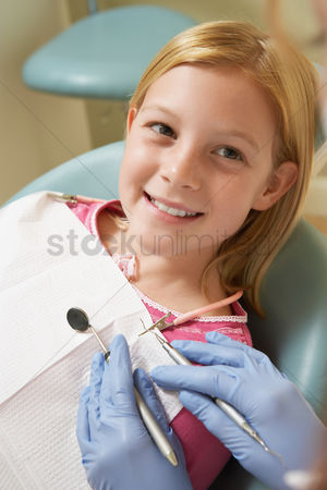 Children : Girl  7-10  at dentists  close-up