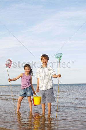 Young boy : Girl and boy playing at beach