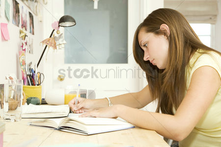 Learning : Girl doing assignment in her room