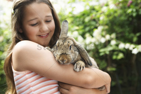 Posed : Girl holding rabbit