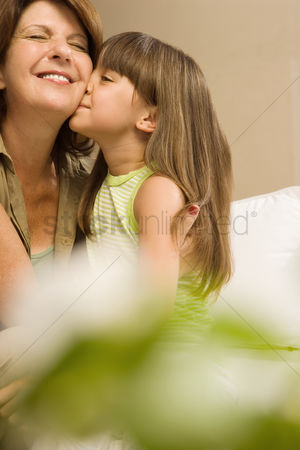 Respect : Girl kissing grandmother