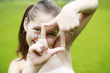 Grass : Girl making a sign