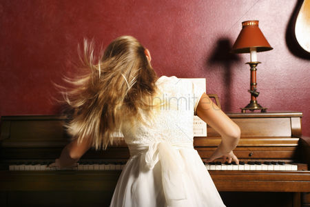 People : Girl playing piano