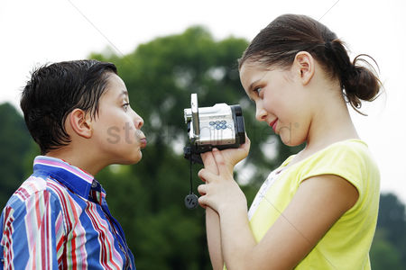 Funny : Girl recording images of boy making a face