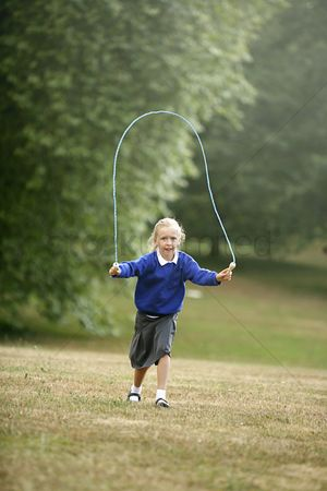 Rope : Girl skipping in a park